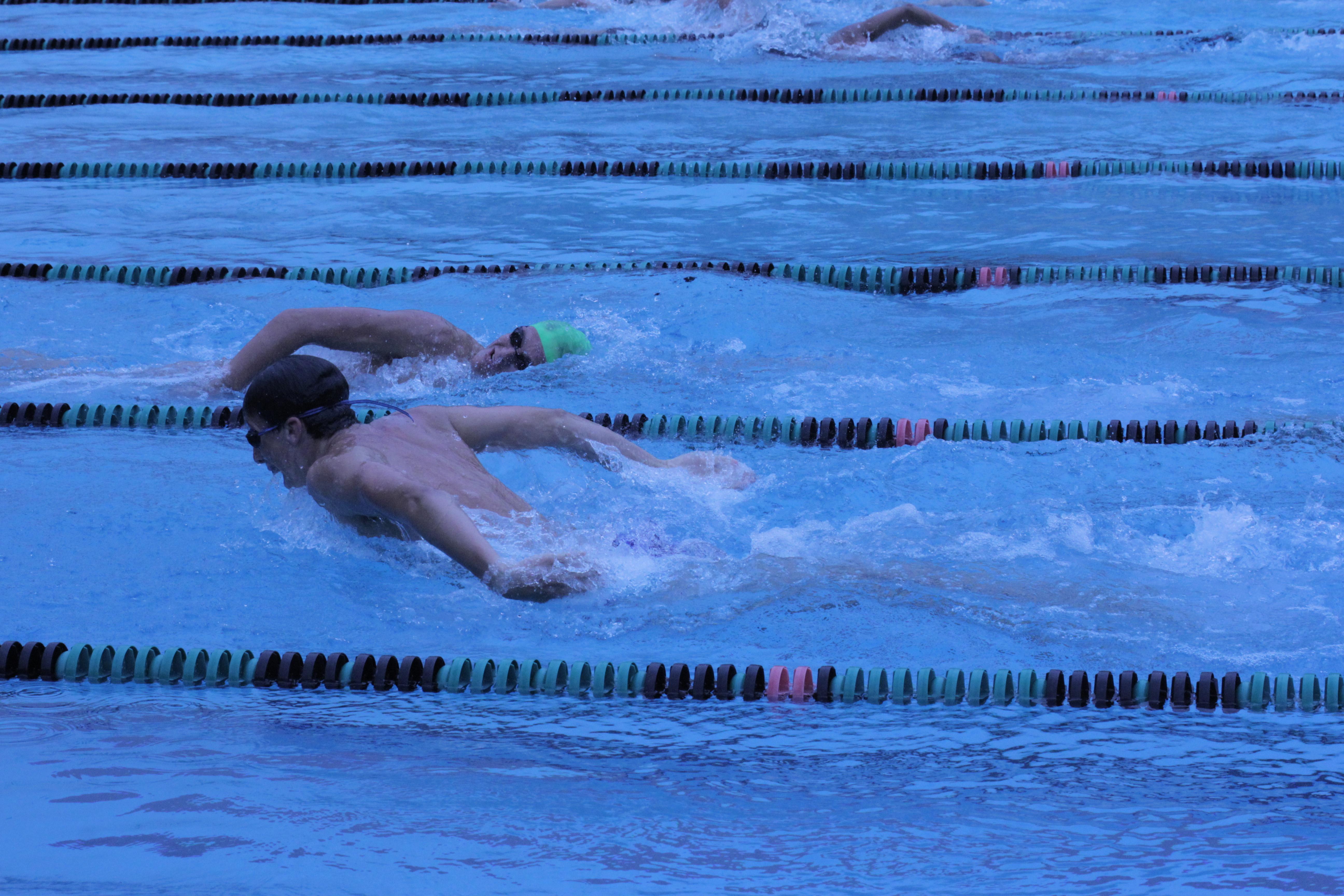 Girls, boys varsity swim and dive teams push for improvement